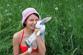 Young smiling woman and rabbit — Stock Photo