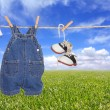 Baby Boy Child Clothes Hanging Outdoors - Stock Photo