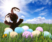 Bunny Rabbit in the Grass With Easter Co — Stock Photo