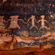 Foto Stock: Native AmericPetroglyphs in Red Sands