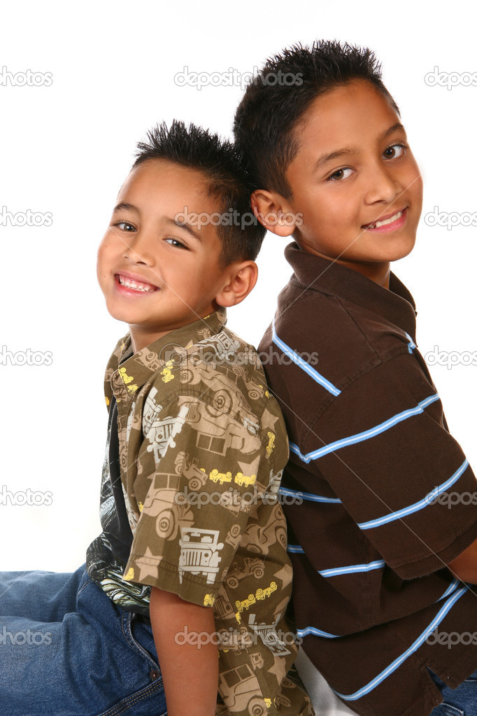 Hispanic American Brothers Sitting With Their Backs Touching While Smiling  Photo #2204607