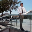 Stock Photo: African American Architect Outdoors Looking On
