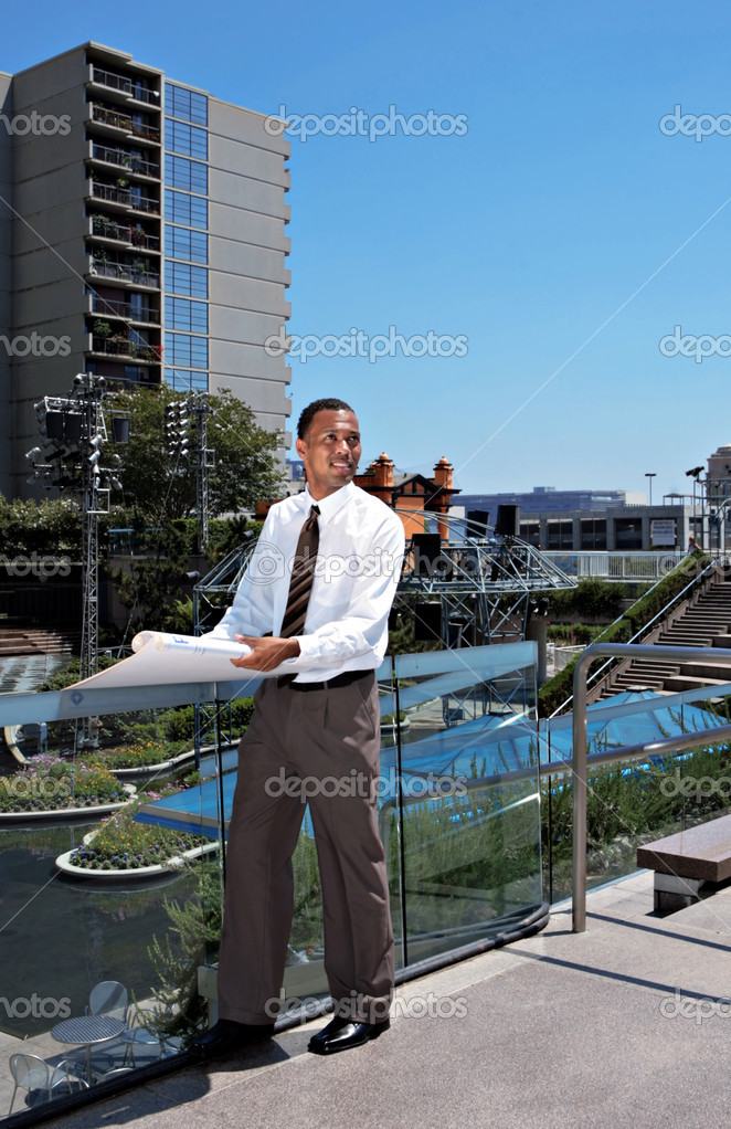 Handsome Architect Reading Blue Prints Outdoors  Stock Photo #2253892