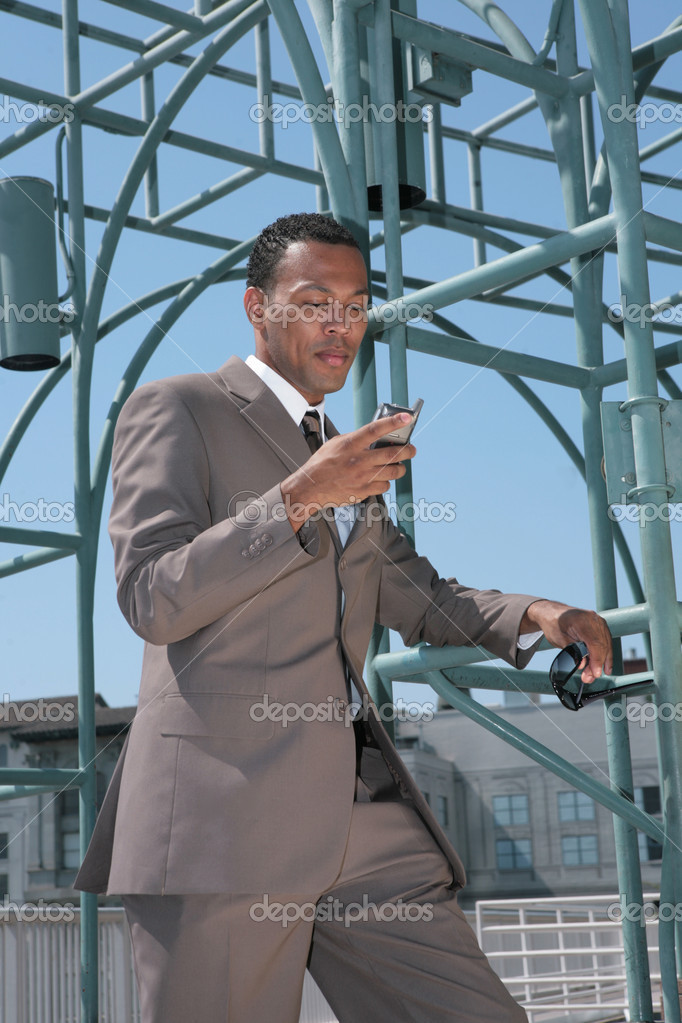 Black Business Man in a Suit Outside Reading Cell Phone — Stock Photo #2254000