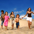 Running Children on the Beach - Stock Photo
