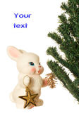 Toy bunny and Christmas tree — Stock Photo