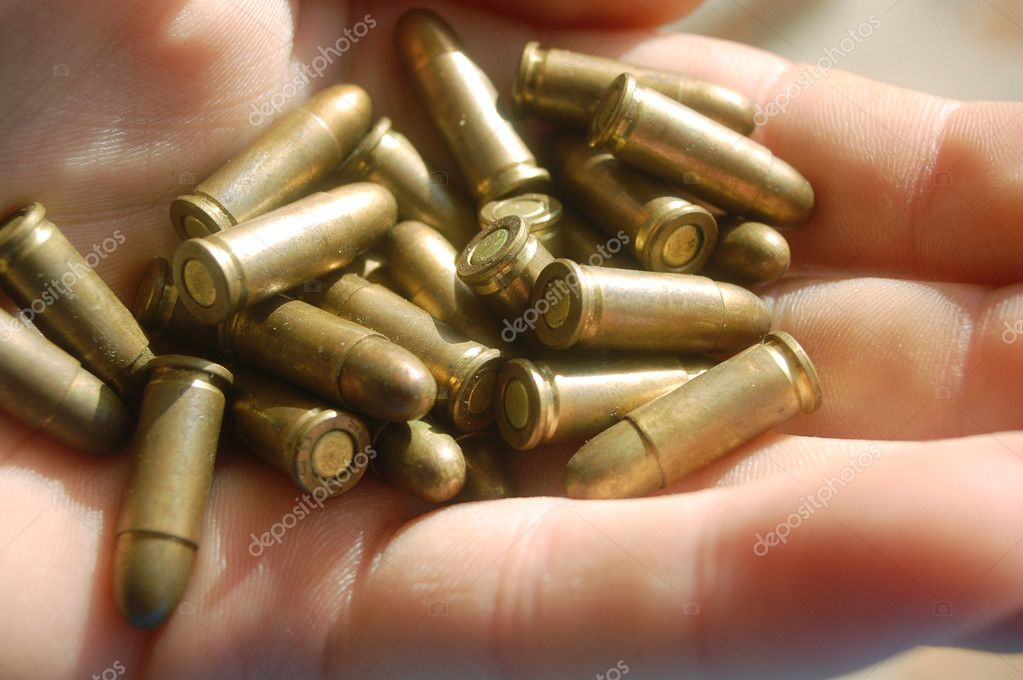 Man holding bullets in hand — Stock Photo #2248838