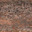 Dirty old wall consist of bricks in city - Stock Photo