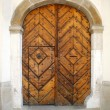 Old oak door with carved stone surround — Stock Photo #2180855