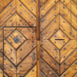 Old oak door with carved stone surround - Stock Photo