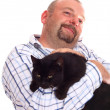 Man holds black cat in hands — Stock Photo