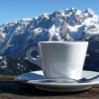 Nice warm cup of cappuccino of the snowy - Stock Photo