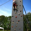 Boy on climbing wall — Stockfoto