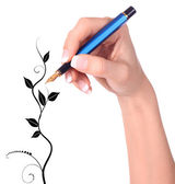 Hand with fountain pen drawing Floral — Stock Photo