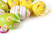 Easter eggs painted on a white backgroun — Stock Photo