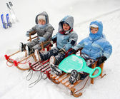 Boys on sled — Stock Photo