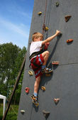 Boy on climbing wall — Stock Photo