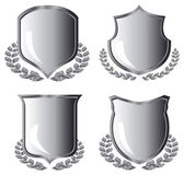 Silver shields with laurel wreath — Stock Vector