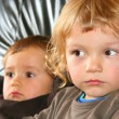 Two young boys on couch — Stock Photo