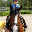 Stock Photo: The young boy rides on a horse
