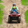 Stock Photo: Dad with son riding quad bike
