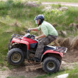 Stock Photo: Men riding on quad