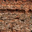 Stock Photo: Dirty old wall consist of bricks in city