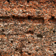 Dirty old wall consist of bricks in city — Foto Stock
