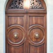 Old oak door with carved stone surround — Stock Photo