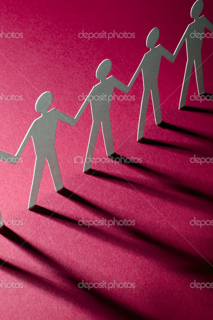 Paper team linked together - figures of man in paper — Stock Photo #2316583