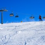 Ski slope covered mountain side — Stock Photo #2416874