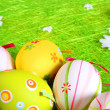 Easter eggs with chamomile on fresh green grass — Stock Photo