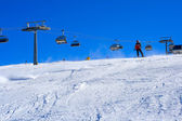 Ski slope covered mountain side — Foto Stock