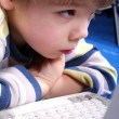 Young boy using a laptop — Stock Photo