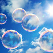 Soap bubbles on blue sky - Stock Photo