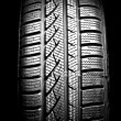 New car tire close up on - Stock Photo