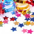 Confetti with streamers — Stock Photo