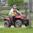 Dad with son riding a quad — Stock Photo