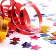 Confetti  with streamers on white — Stockfoto