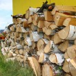 Stacked winter logs for heating — Stock Photo