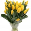 Yellow tulips in a vase - Stock Photo