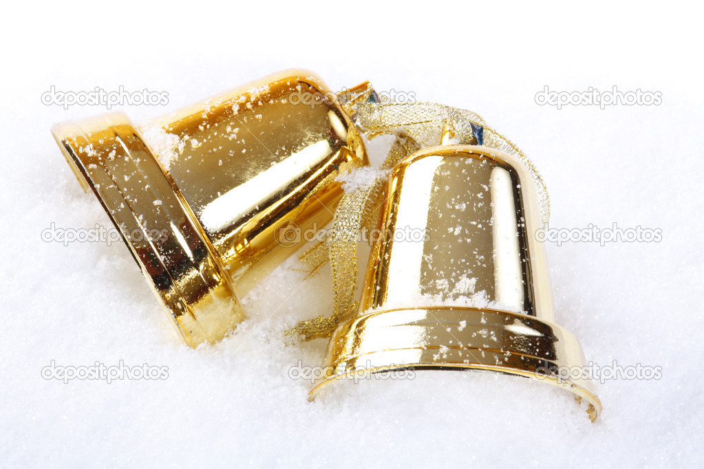 Christmas gold bells over white snow background — Stock Photo #2672773