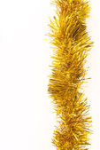 Gold tinsel — Stock Photo