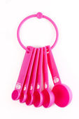 Pink plastic baking utensils — Stock Photo