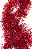 Red tinsel — Stockfoto