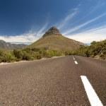 Road leading toward mountain — Stock Photo #2327563