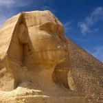 Sphinx and pyramid — Stock Photo