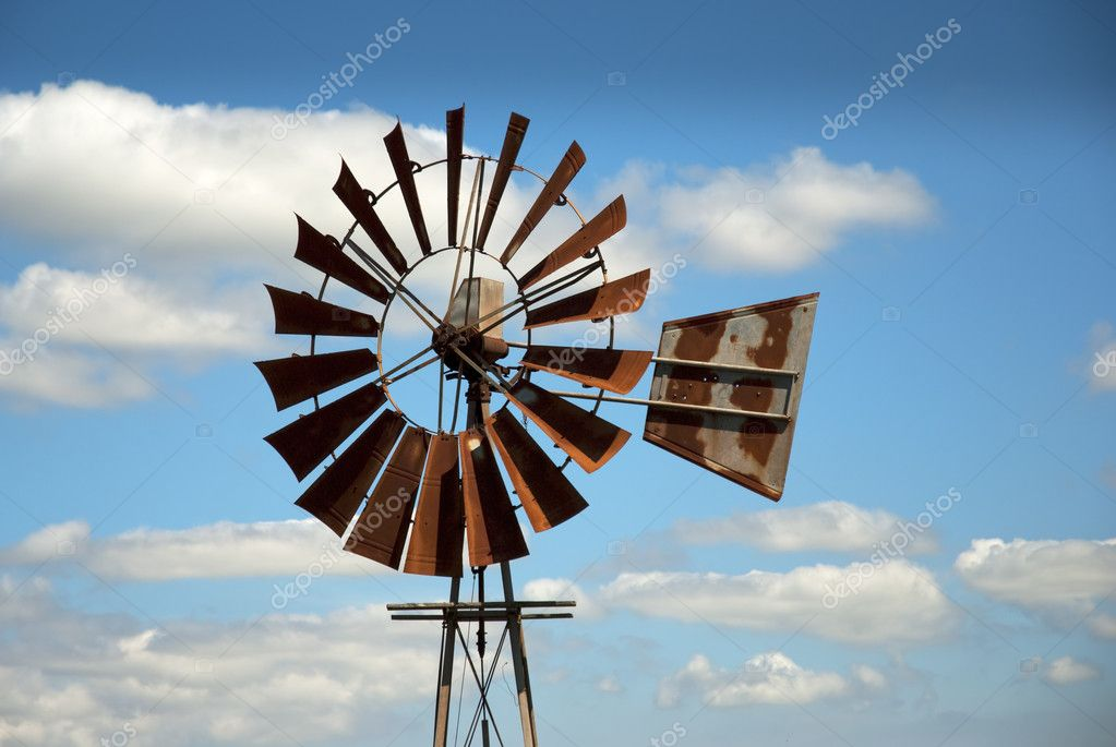 Rusty windmill with clouds in the background  Stock Photo #2328205