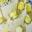White wedding cake with roses - Stock Photo
