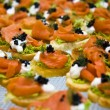 Salmon and caviar starters — Stock Photo